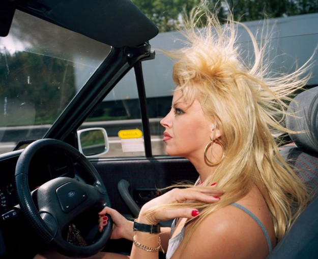 GB. England. 'I feel that other women on the road react to me in a nasty hostile sort of way. For some reason this hate comes across. I mean, I give way to them so why don't they give way to me'. From 'A to B'. This image was used as the front cover of 'From A to B' 1994.