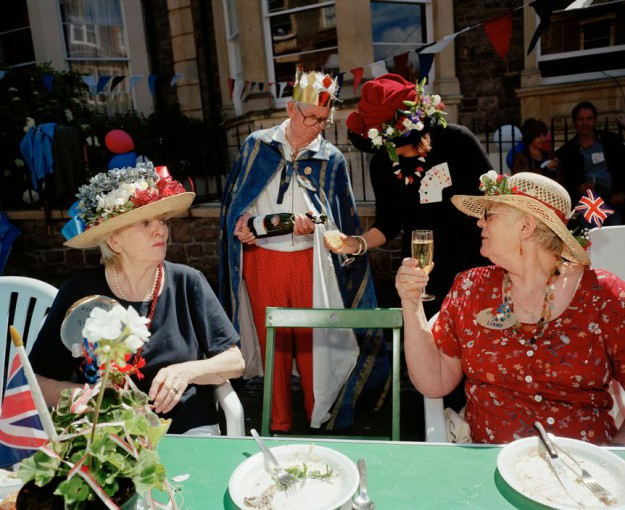 GB. England. Bristol. Neighbours from Goldney Avenue gather to celebrate the Queen's Golden Jubilee. The theme for the party is Kings and Queens. 2002.